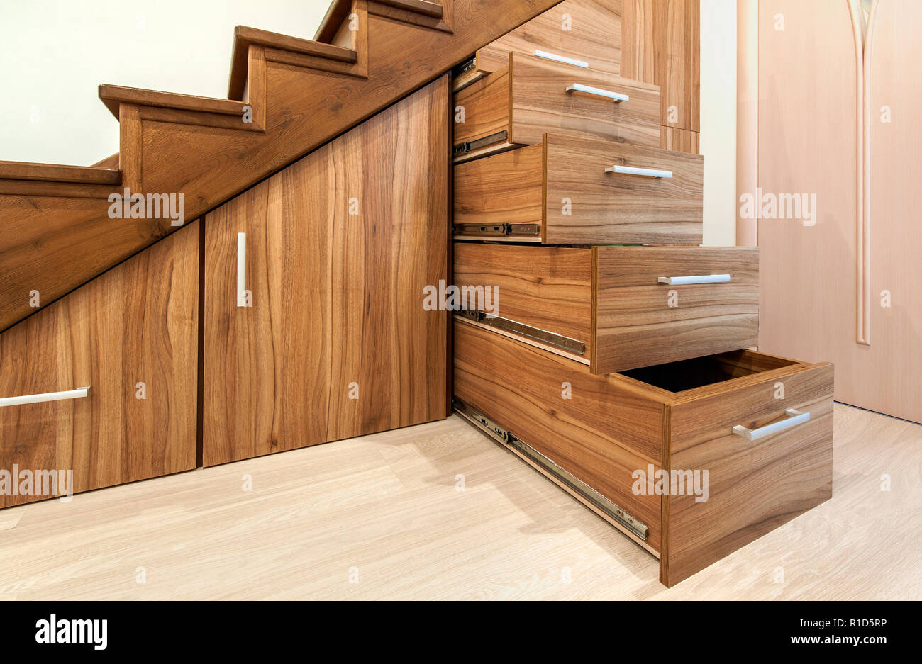 Modern architecture interior with luxury hallway with glossy wooden stairs in modern storey house custom built pullout cabinets on glides in slots u