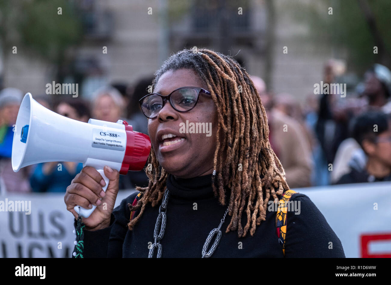 A black woman seen speaking on a megaphone during the demonstration. A new manifestation against institutional racism has crossed the streets of the center of Barcelona. Accompanied by social organizations and the Trade Union of street vendors, more than 500 people have claimed to end racism in Barcelona and have denounced police identifications according to the color of their skin. - Stock Image