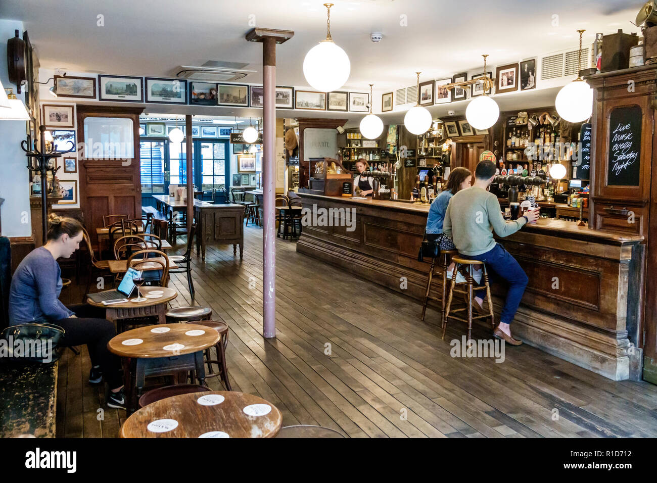London England United Kingdom Great Britain South Bank Southwark Union Street Mc & Sons Pub traditional old Irish boozer public house bar worn out woo - Stock Image