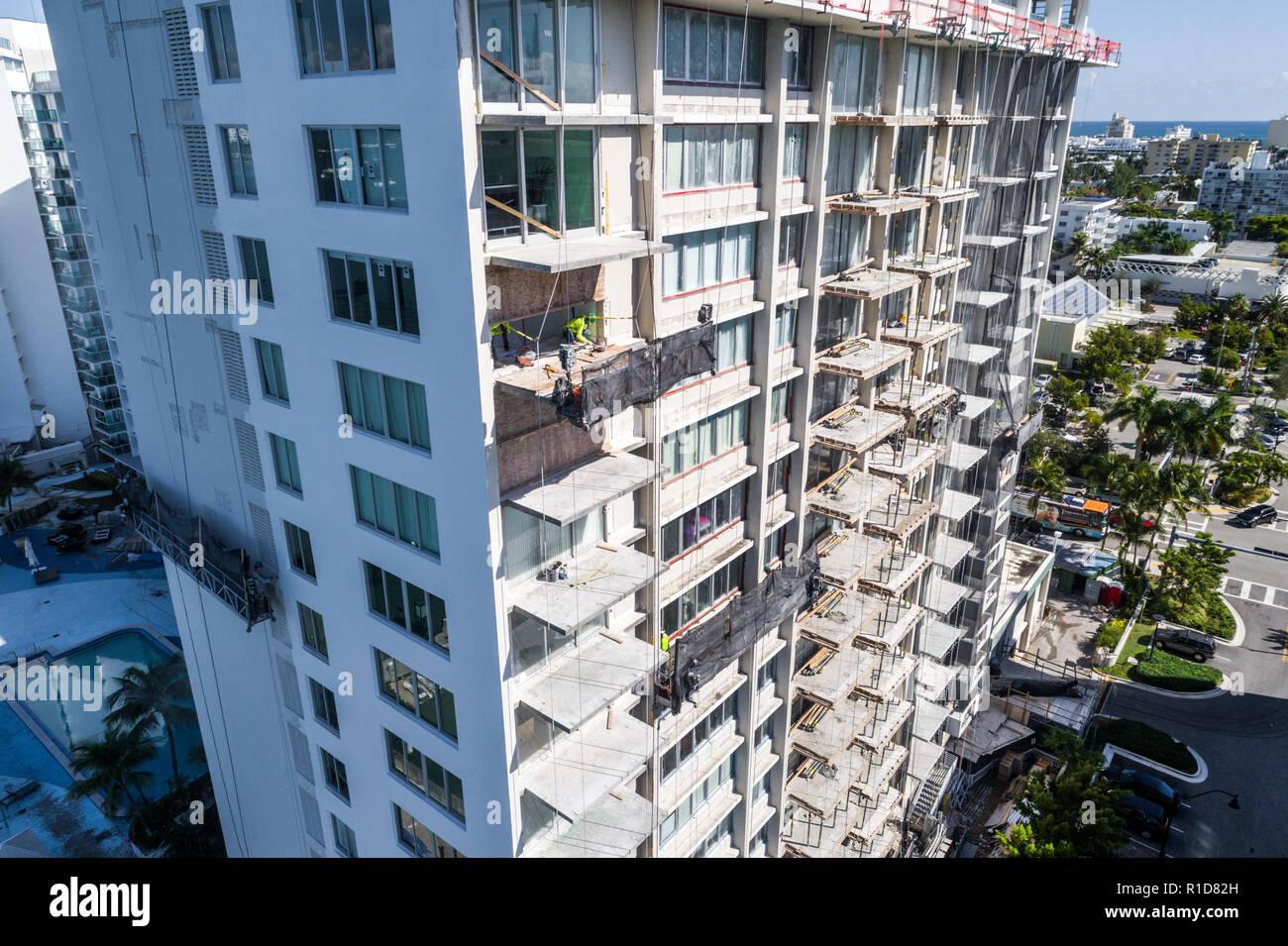 Miami Beach Florida aerial overhead bird's eye view above repair renovation replacement balconies Mirador 1000 high rise condominium building - Stock Image