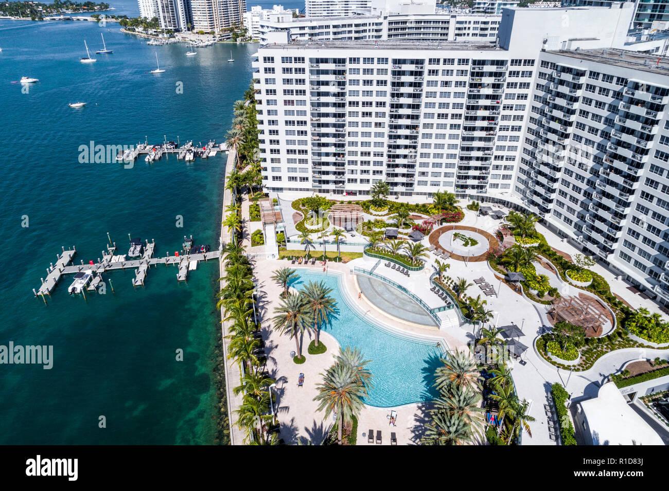Miami Beach Florida Biscayne Bay aerial overhead bird's eye view above Flamingo South Beach condominium high rise buildings boats water waterfront swi Stock Photo