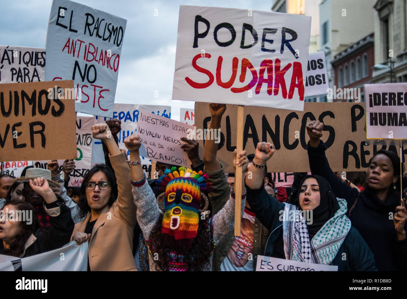 Madrid. Spain. 11th, Nov, 2018. People protesting during a demonstration under the slogan 'Against institutional racism' in Madrid, Spain. Credit: Marcos del Mazo/Alamy Live News - Stock Image