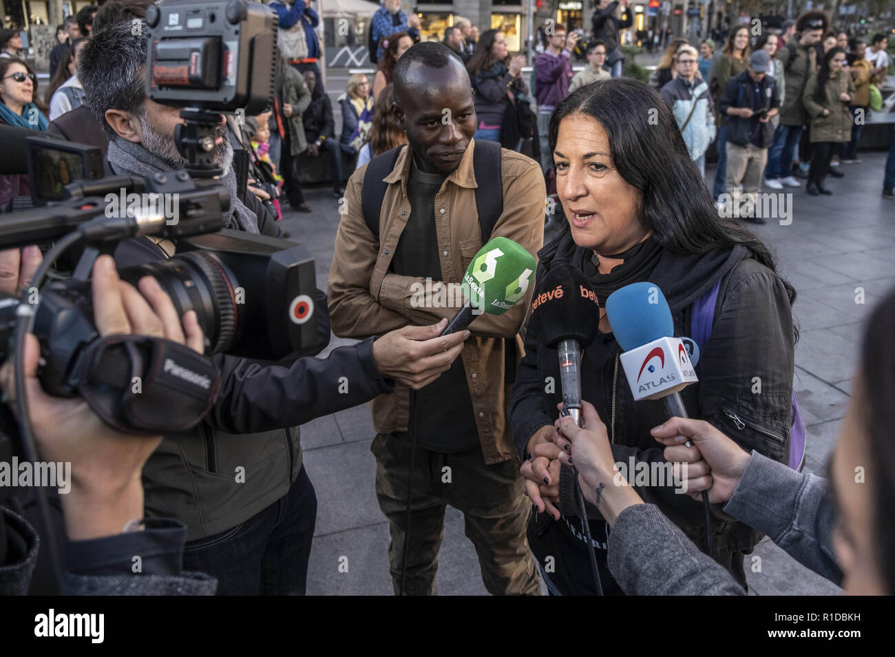 Barcelona, Catalonia, Spain. 11th Nov, 2018. The spokespersons for the demonstration against institutional racism is seen at a press conference during the protest.A new manifestation against institutional racism has crossed the streets of the center of Barcelona. Accompanied by social organizations and the Trade Union of street vendors, more than 500 people have claimed to end racism in Barcelona and have denounced police identifications according to the color of their skin. Credit: Paco Freire/SOPA Images/ZUMA Wire/Alamy Live News - Stock Image
