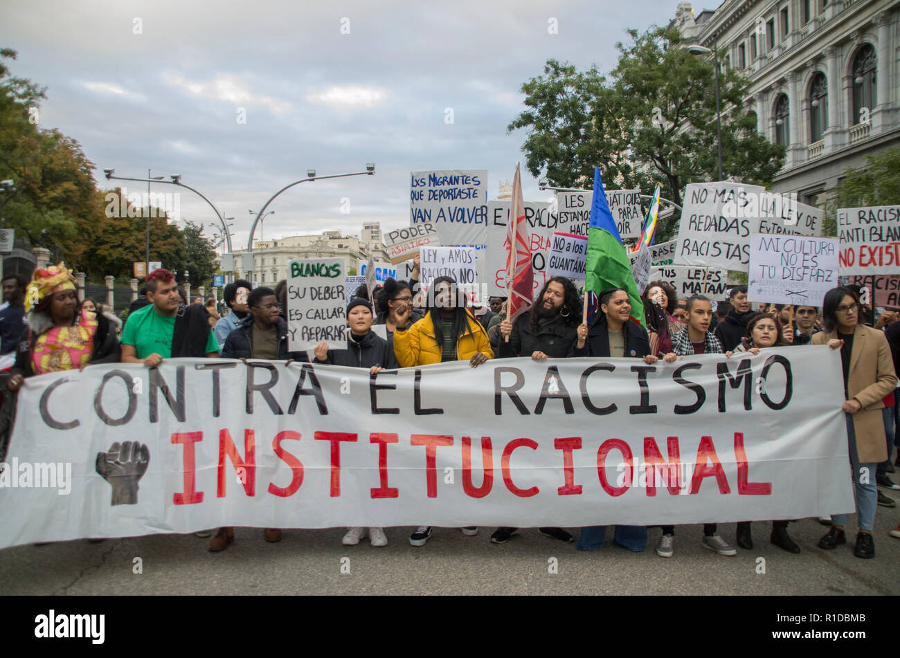 Hundreds of people of different nationalities protested against racism in Spanish institutions in Madrid. - Stock Image