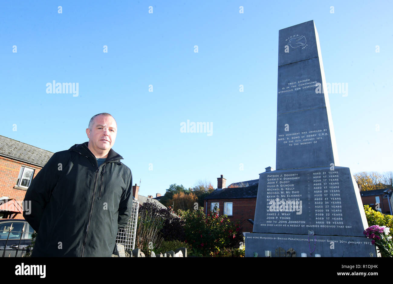 Londonderry, UK. 08th Nov, 2018. Gleann Doherty stands next to a memorial commemorating the victims of Bloody Sunday in 1972, when British soldiers shot 13 demonstrators and injured 13 others. Glenn's father Patrick Doherty was one of those killed on Bloody Sunday. Some of the worst acts of violence during the riots took place in the area. Today Derry is a tourist attraction because of the political murals. (to dpa 'The Great Fear of Brexite in Northern Ireland' of 12.11.2018) Credit: Jonathan Porter/PressEye/dpa/Alamy Live News - Stock Image