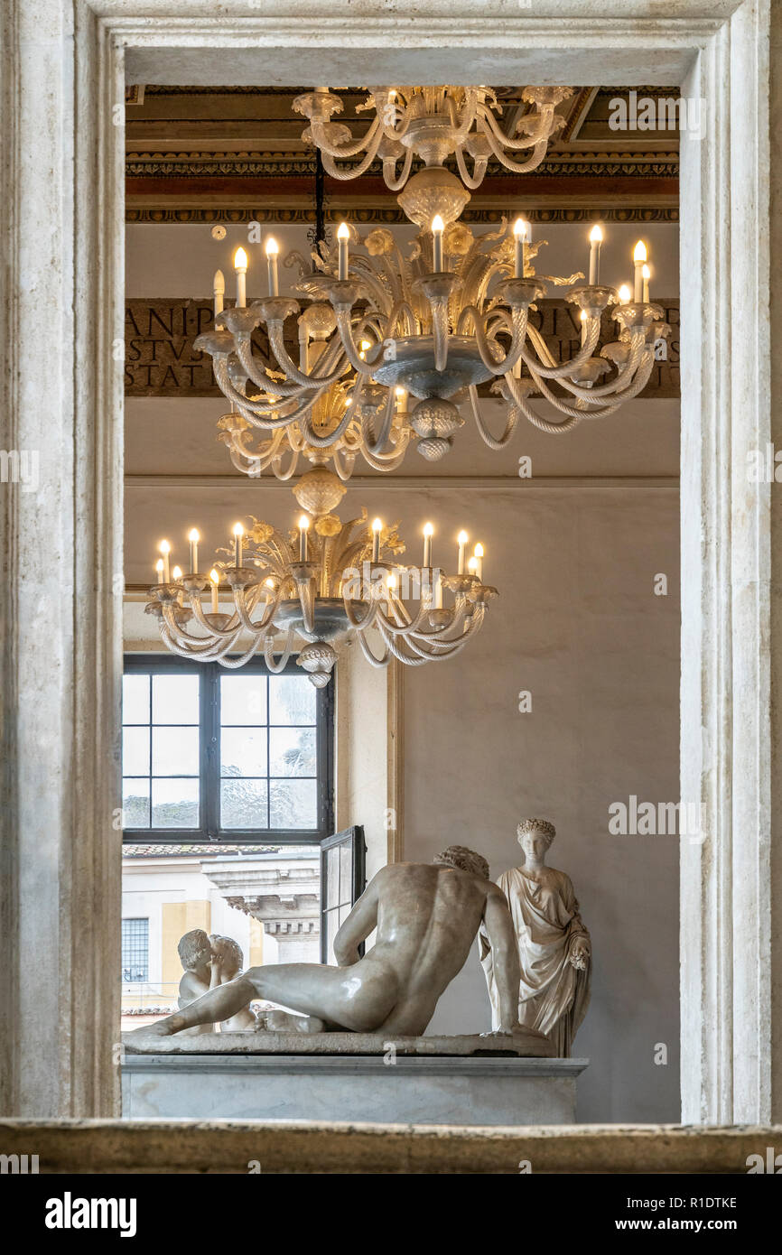 Chandeliers in the Hall of the Galatian  above  the sculpture of the Dying Galatian,  in the Palazzo Nuovo, part of the Capitoline Museums, Rome, Ital - Stock Image