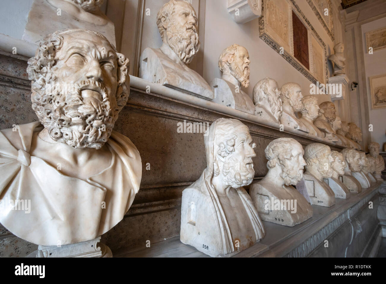 Marble busts of philosophers in the Hall of the Philosophers, in the  Capitoline Museums,  Rome, Italy. - Stock Image