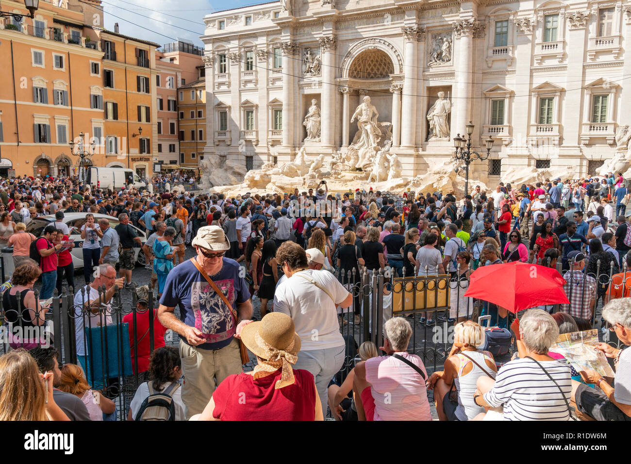 Hordes of tourists visiting the Trevi Fountain, one of the most popular tourist attractions in  Rome, Italy. - Stock Image