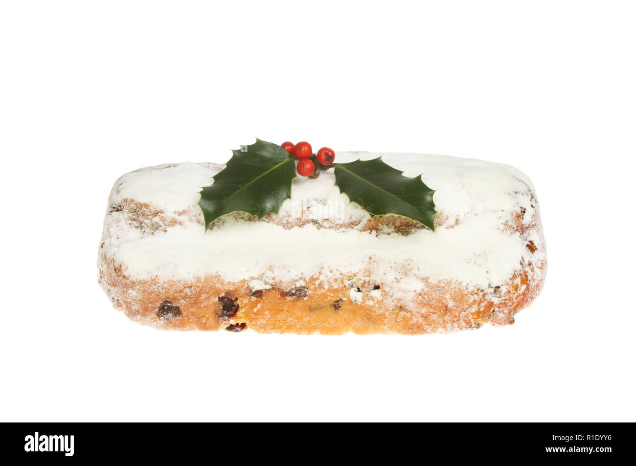 Stollen decorated with holly isolated against white - Stock Image