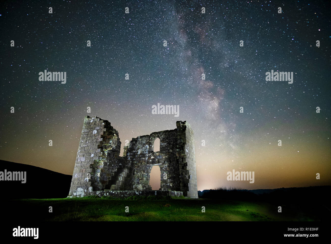 The milky way over Skelton Tower on the North York Moors near Levisham. - Stock Image