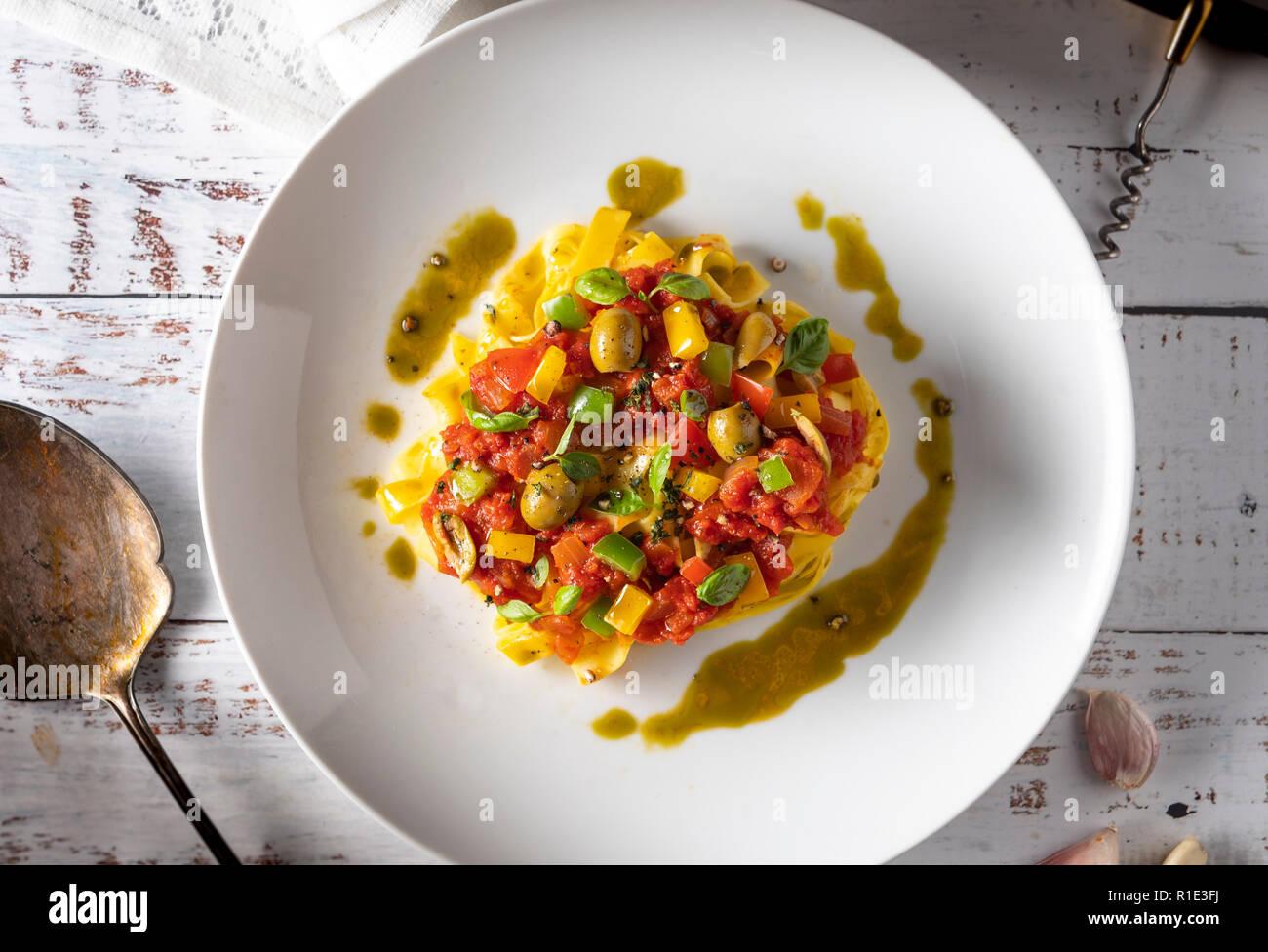 Flat lay bowl of Italian Tagliatelle pasta Stock Photo