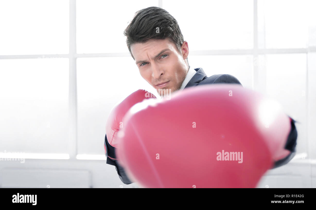 confident young businessman in Boxing gloves - Stock Image