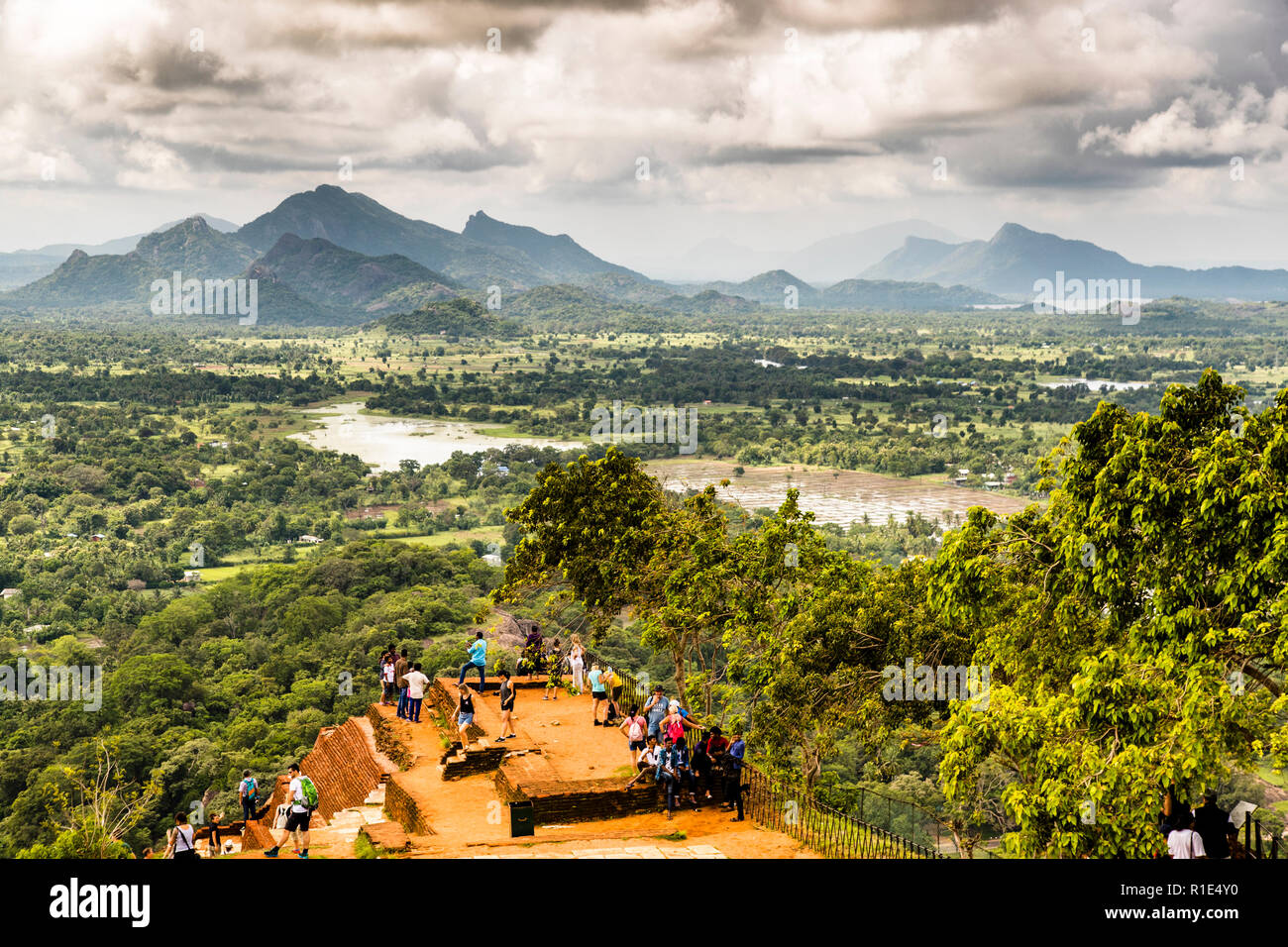 Breathtaking view from the Sigiriya rock fortress over rice fields and mountain ranges in the distance Stock Photo