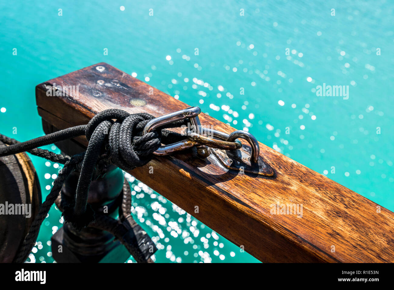 Wooden Row on Carbine with Blue Ocean - Stock Image