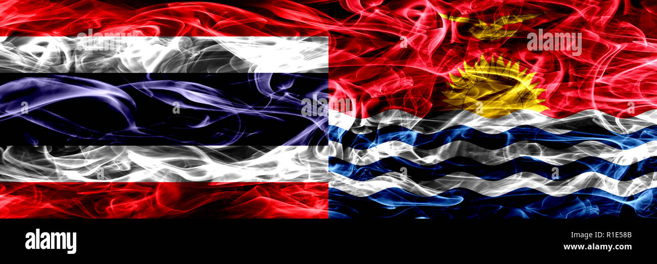 Thailand vs Kiribati smoke flags placed side by side. Thick abstract colored silky smoke flags - Stock Image