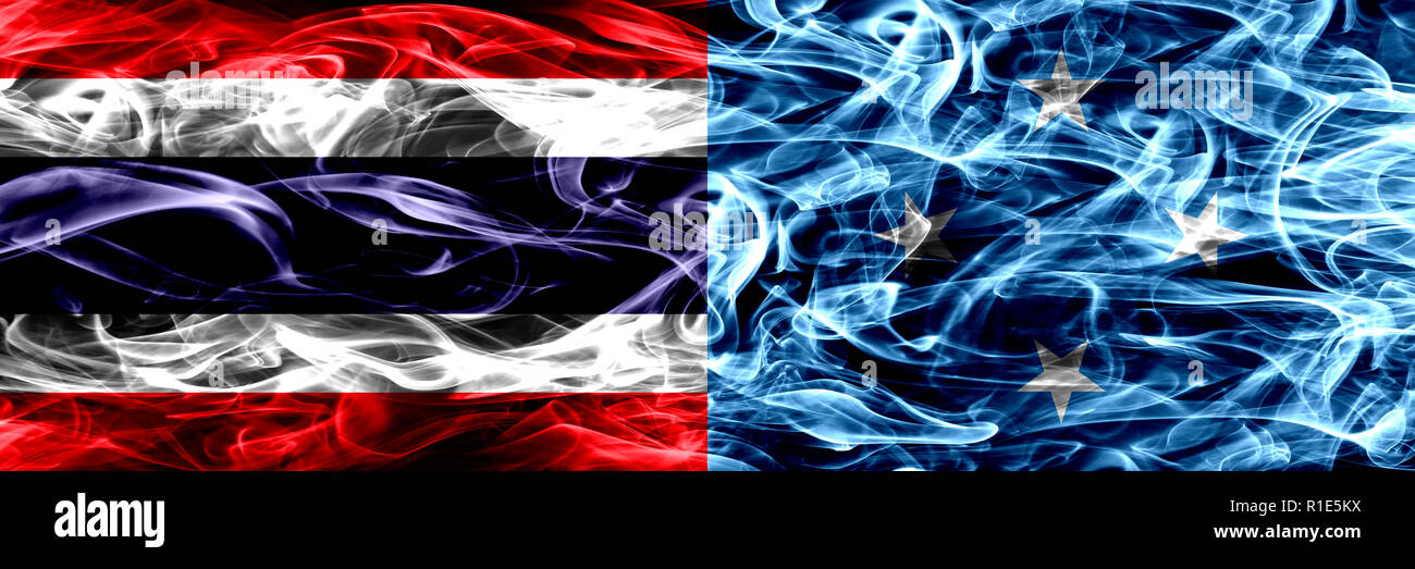 Thailand vs Micronesia, Micronesian smoke flags placed side by side. Thick abstract colored silky smoke flags - Stock Image