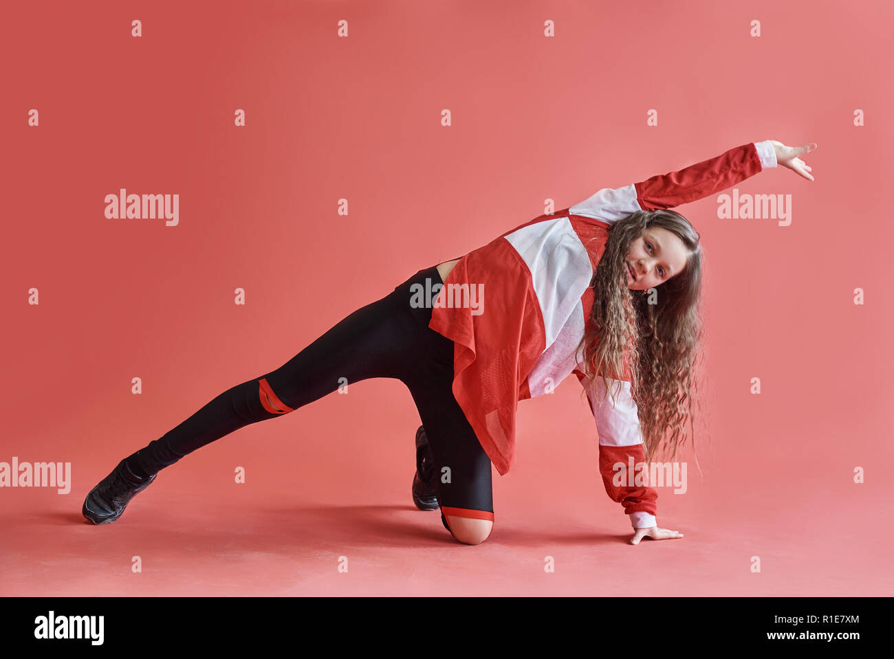 Young Beautiful Cute Girl Dancing On Red Background Modern Slim Hip Hop Style Teenage Girl Jumping Stock Photo Alamy
