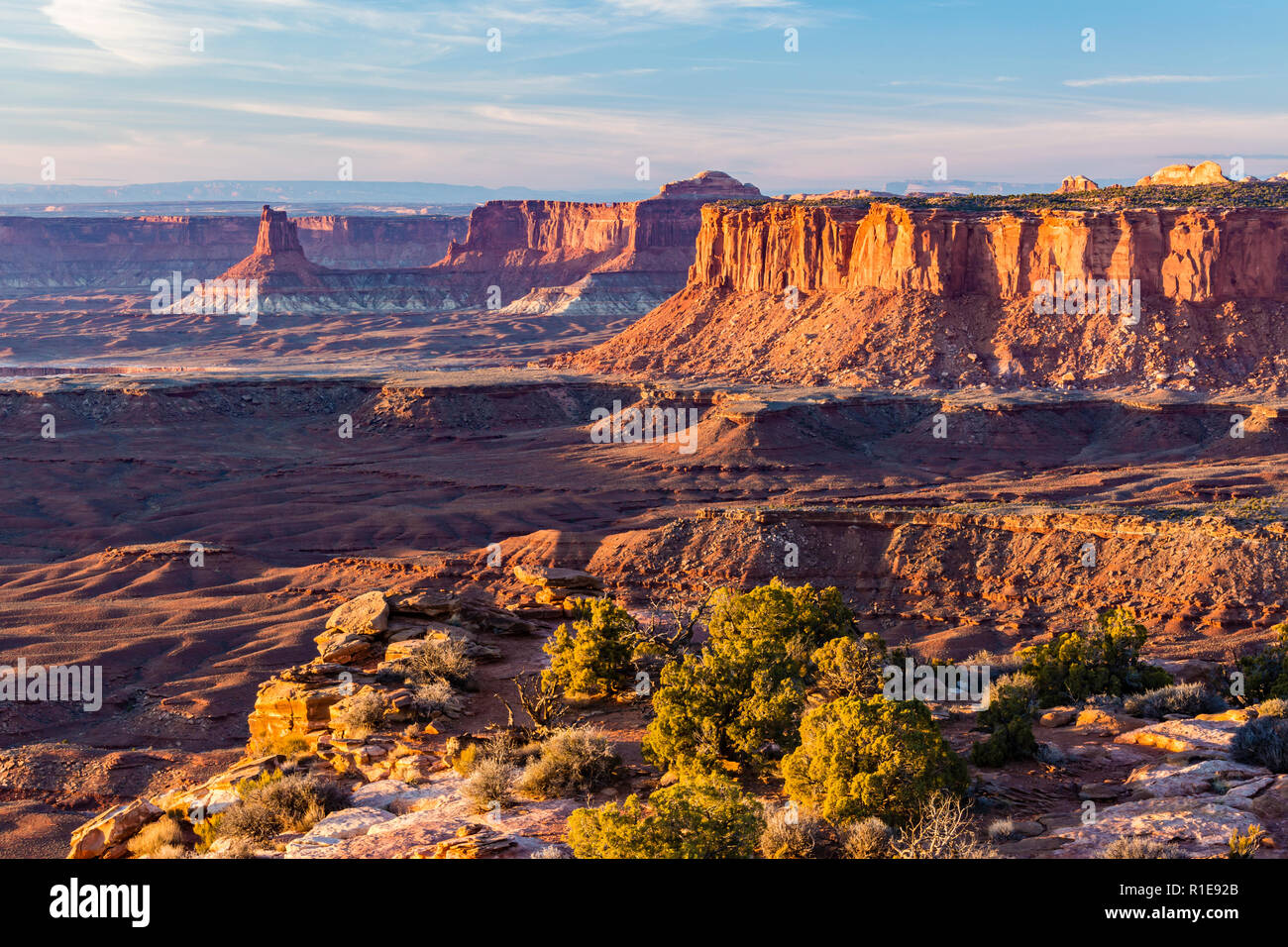 Golden Hour Light on Candlestick Tower and the Island in the Sky from the end of Grand Viewpoint in Canyonlands National Park, Utah. - Stock Image