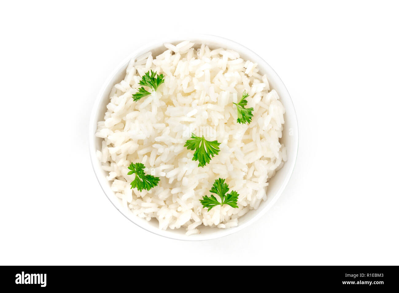 A photo of a bowl of cooked white long rice, shot from the top on a white background with a place for text - Stock Image