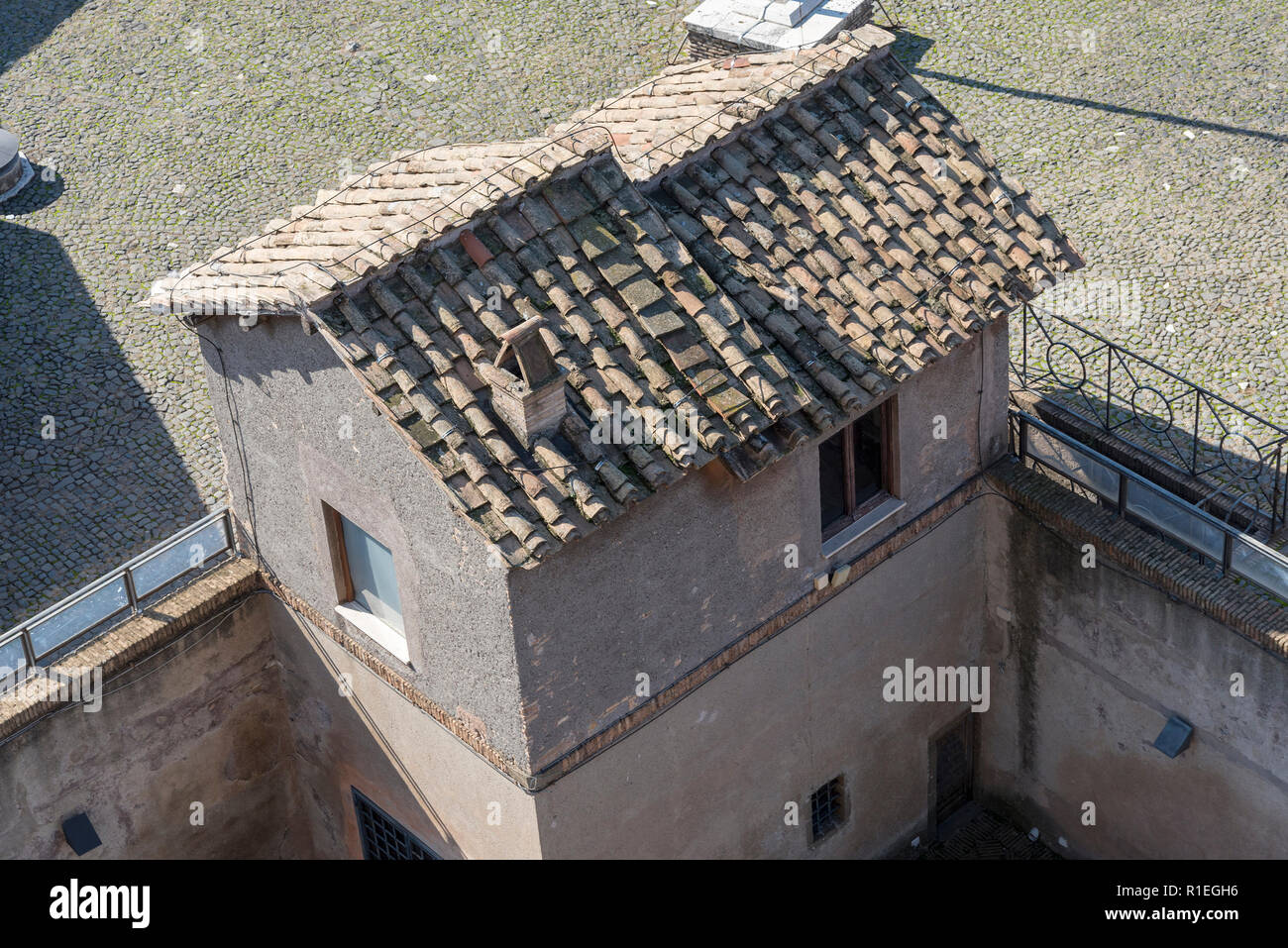 Small house with an old roof top view. Old house in Rome. Stock Photo