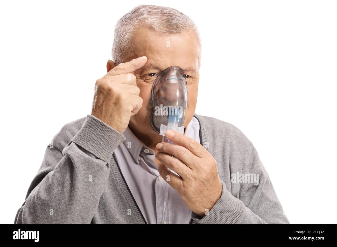 Elderly man using an inhalation mask isolated on white background - Stock Image