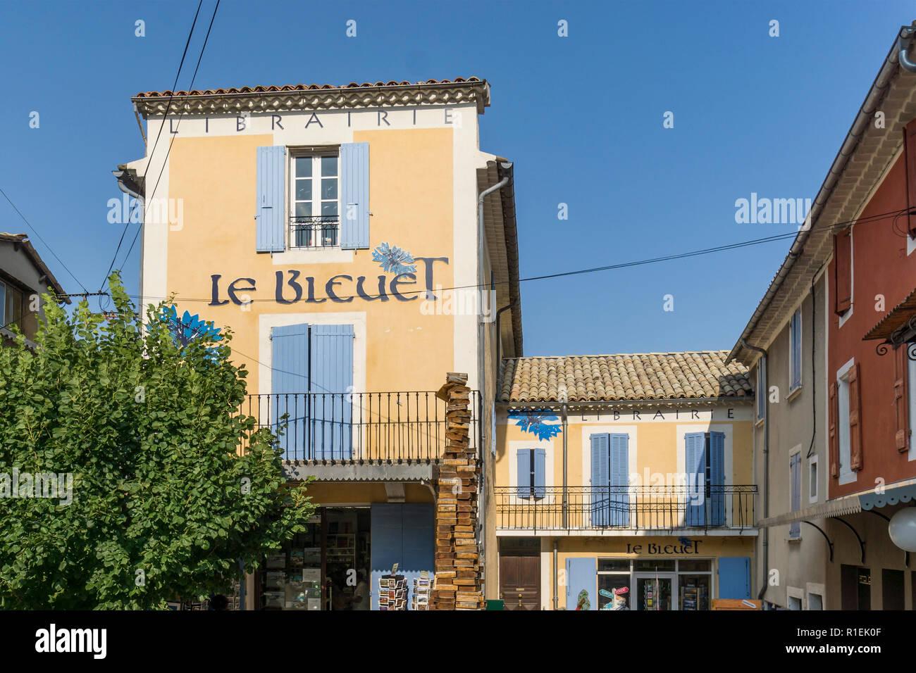 """bookshop entrance, in Banon (France). Librairie les """"Bleuets"""", à Banon, Stock Photo"""
