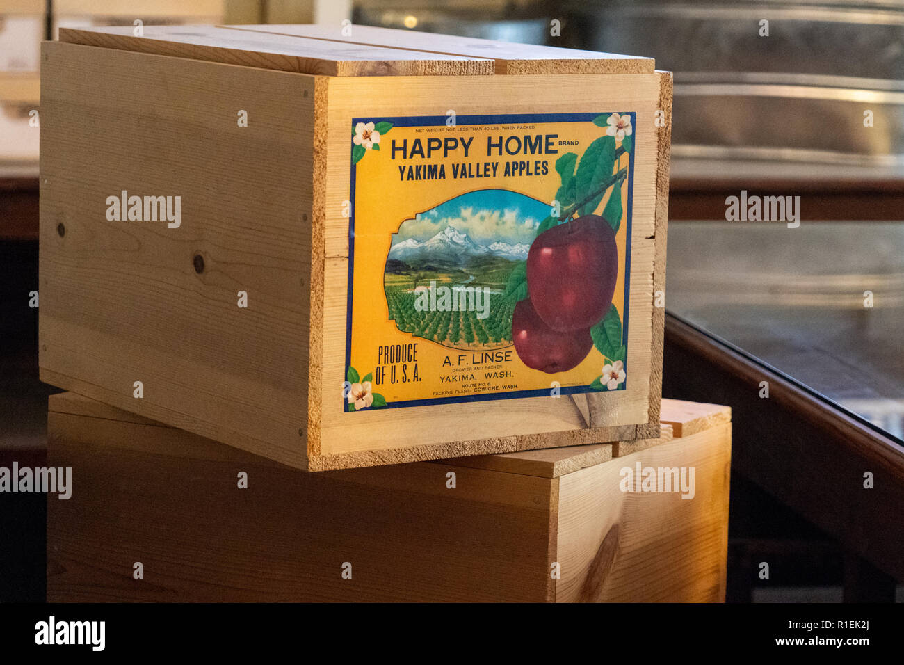 August 8 2018 - McCarthy, Alaska: Old abandoned fruit crates of apples from Washington state sit in the Kennecott Mine abandoned store - Stock Image