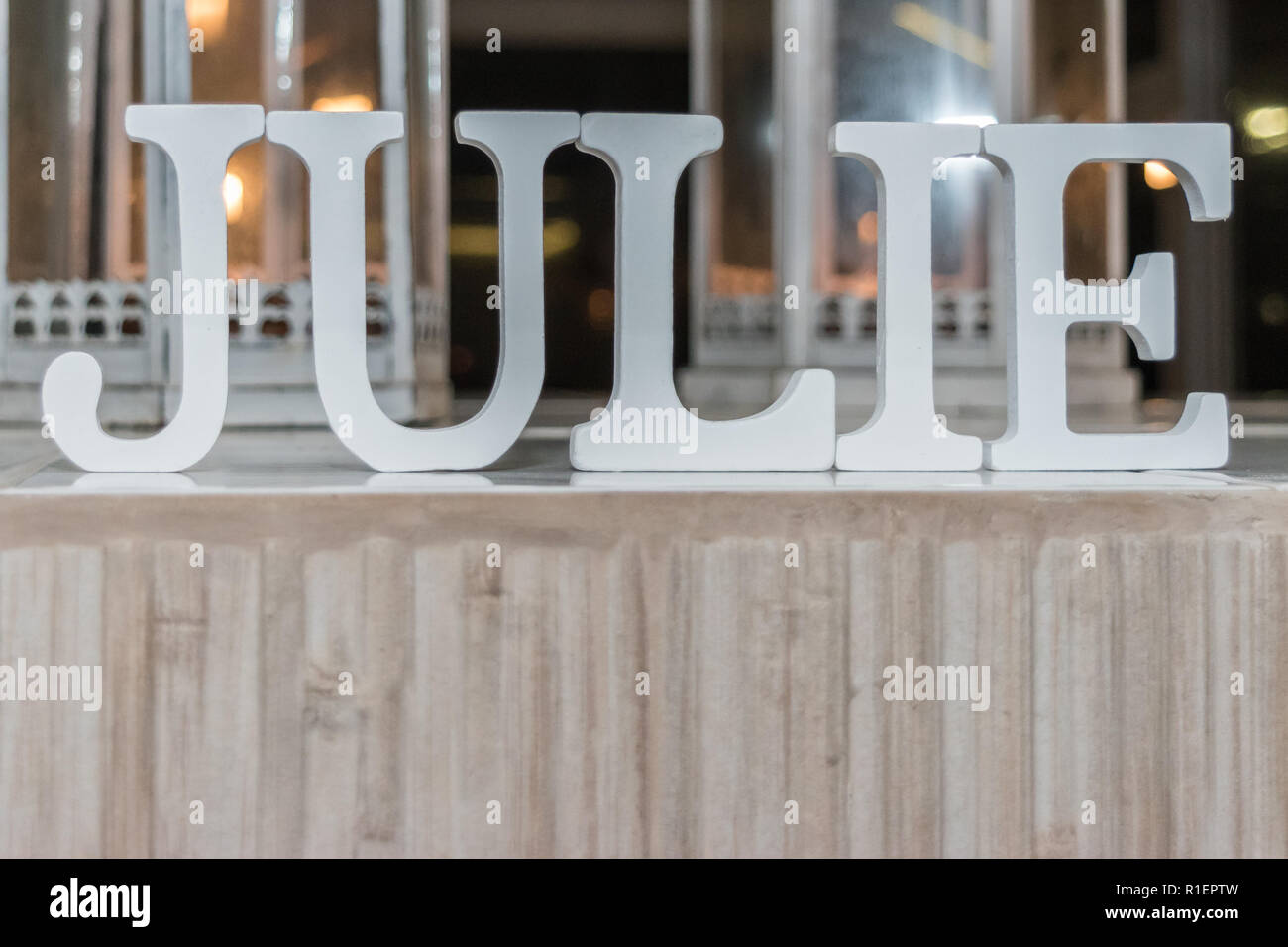 JULIE Name made of large white blocks style font for a Baptism Party - Stock Image