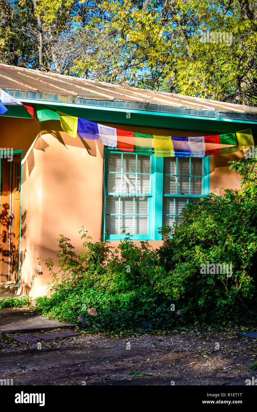 Partial View Of A Simple Adobe Home With Turquoise Paint Trim Accented With Tibetan Prayer Flags Colorfully Displayed During Sunset In Santa Fe Nm Stock Photo Alamy