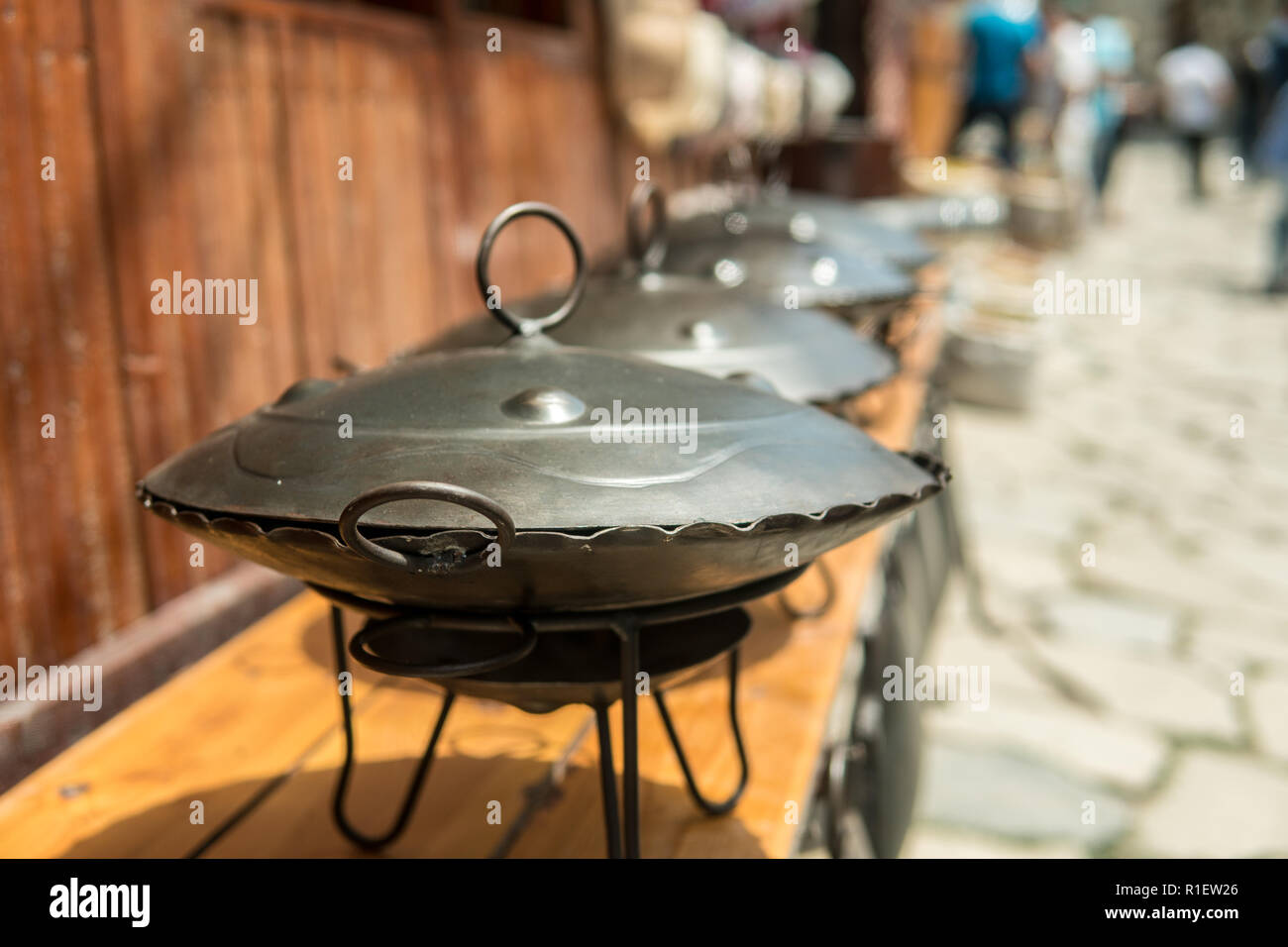 Eastern Saj pots for barbacue or kebap for sale at the market. - Stock Image