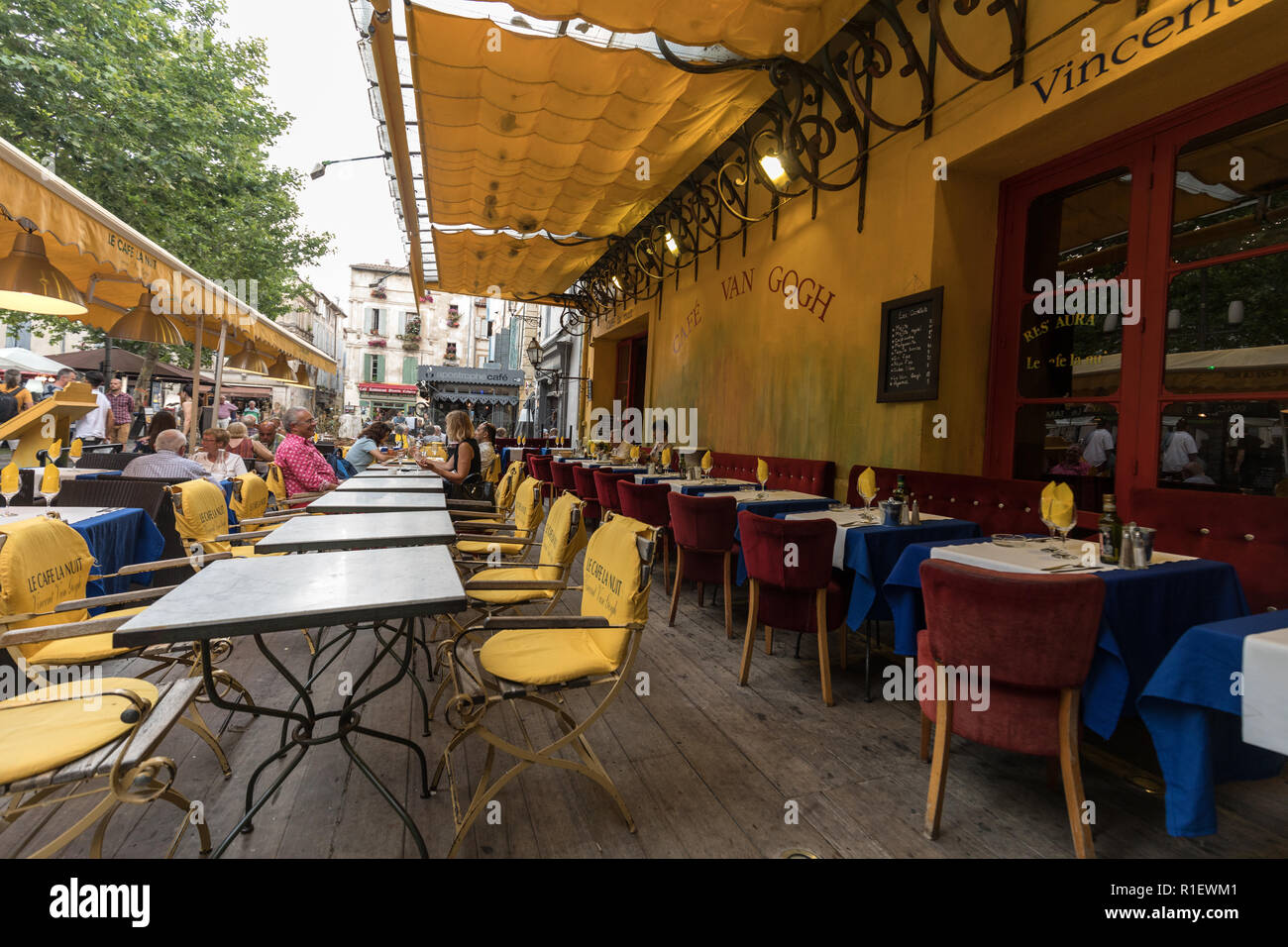 Arles, France - June 24, 2017: Cafe Van Gogh at Place du Forum in Arles. Provence, France. This is the same Cafe Terrace that Vincent van Gogh painted - Stock Image
