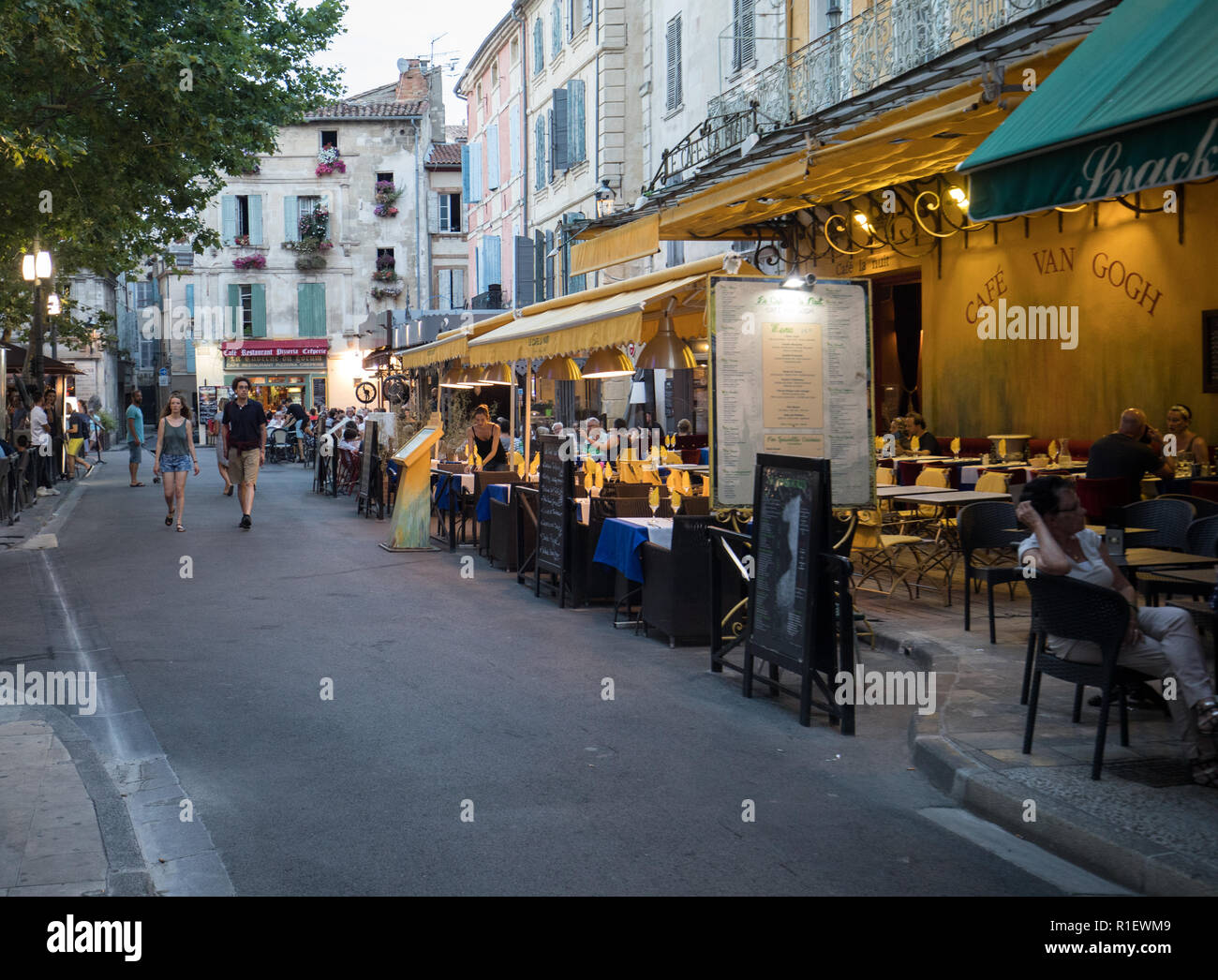 Arles, France - June 24, 2017: People sitting at a cafe in Place du Forum, Arles, Provence, France. - Stock Image