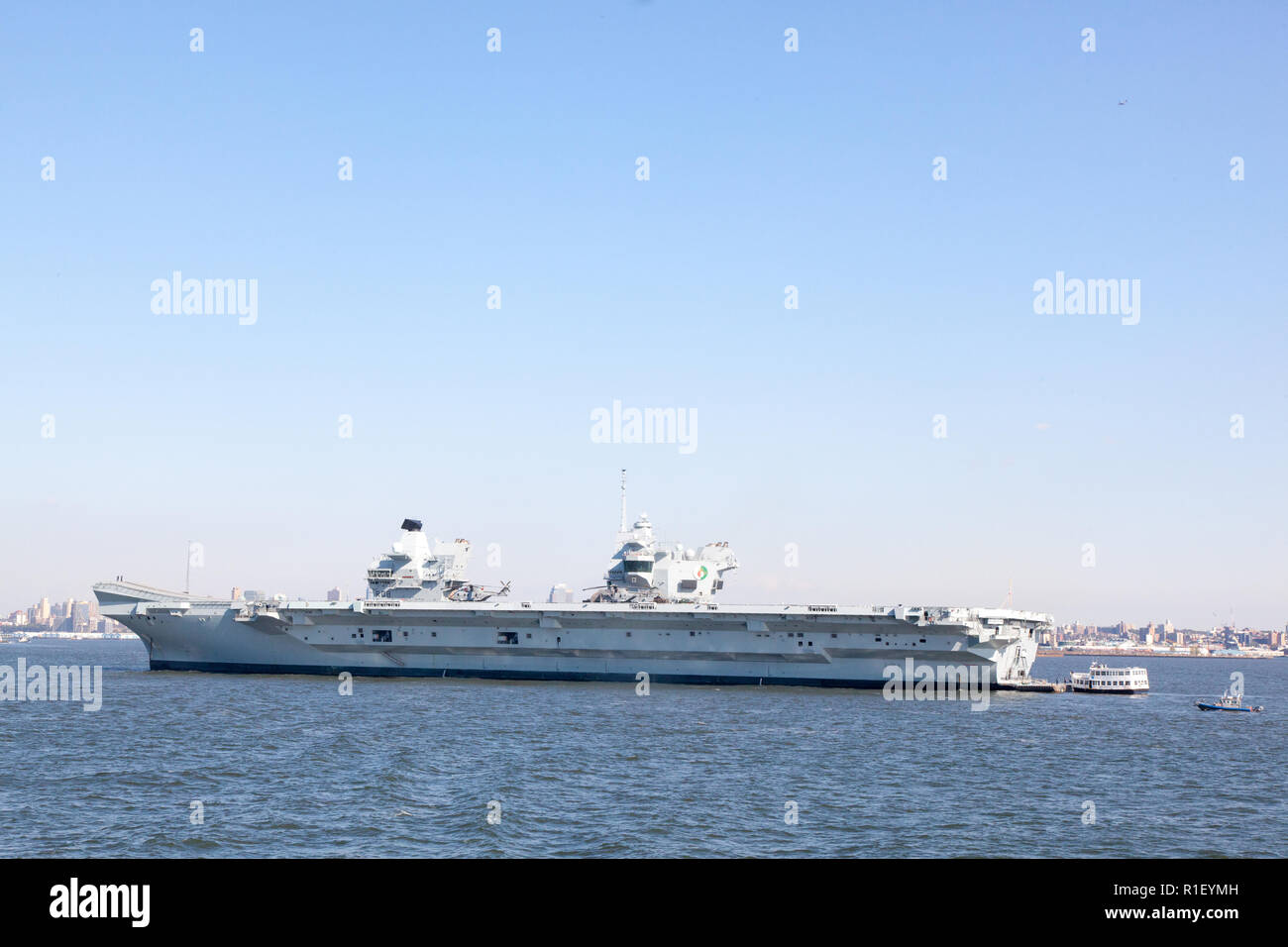HMS Queen Elizabeth Aircraft Carrier, the Royal Navy's largest and newest warship, moored New York harbor, United States of America. Stock Photo