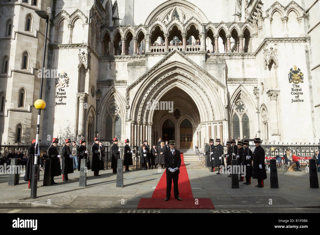 The Royal Courts of Justice London. With the Honourable Artillery Company (HAC) outside, awaiting arrival of the Lord Mayor. - Stock Image