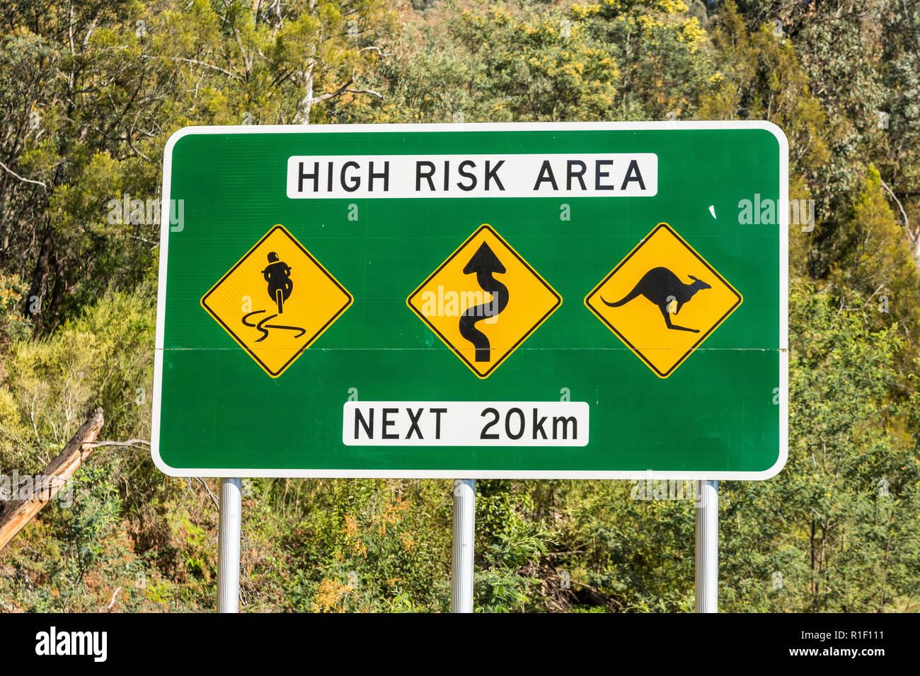 High Risk Area Next 20km Road Sign slippery windy kangaroos Stock Photo