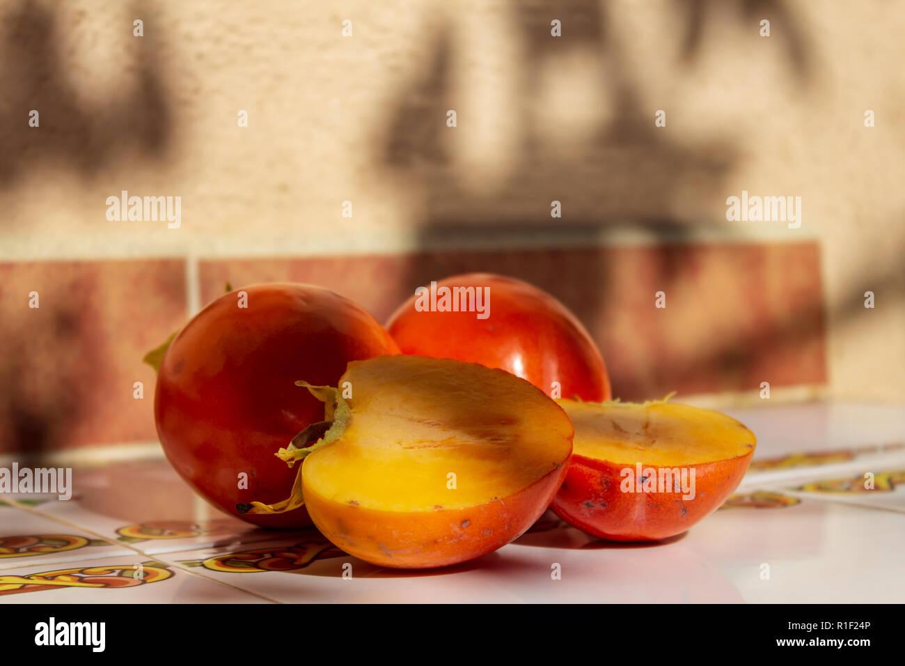 Diospyros kaki, Persimmon Fruit, ripe and ready to eat,  November 2018, Spain Stock Photo