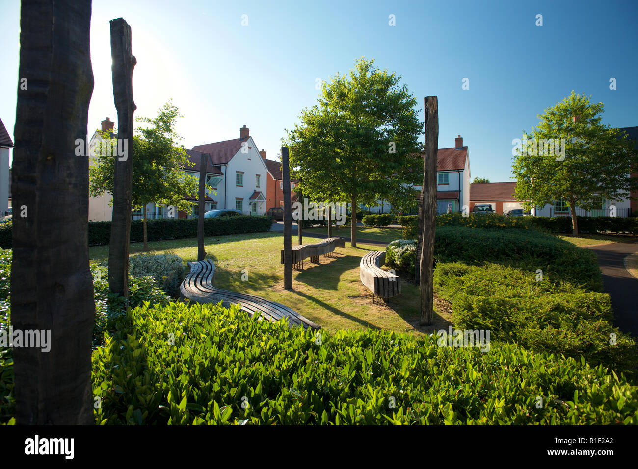 Town planning and urban planning. Communal areas of a new housing development to promote nature and communal play area. - Stock Image