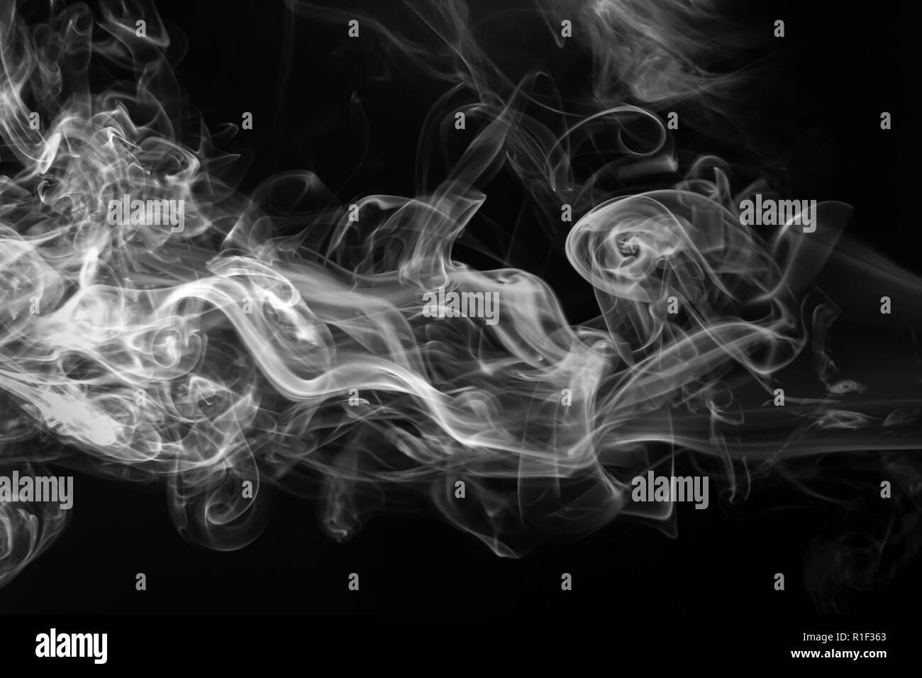white smoke on black background, darkness concept - Stock Image