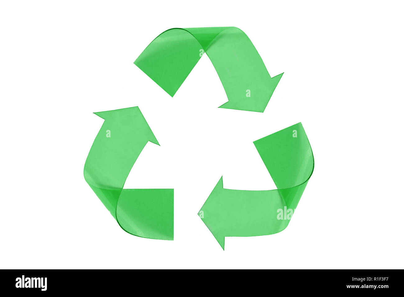 Recyclig symbol made of green plastic on white background - Stock Image