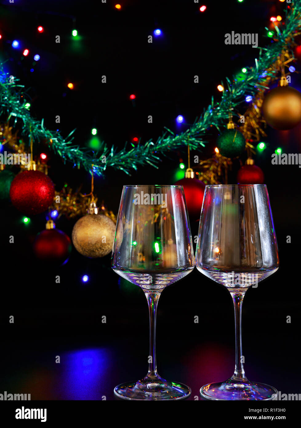 Two Wine Glasses Against A Background Of Colorful Christmas