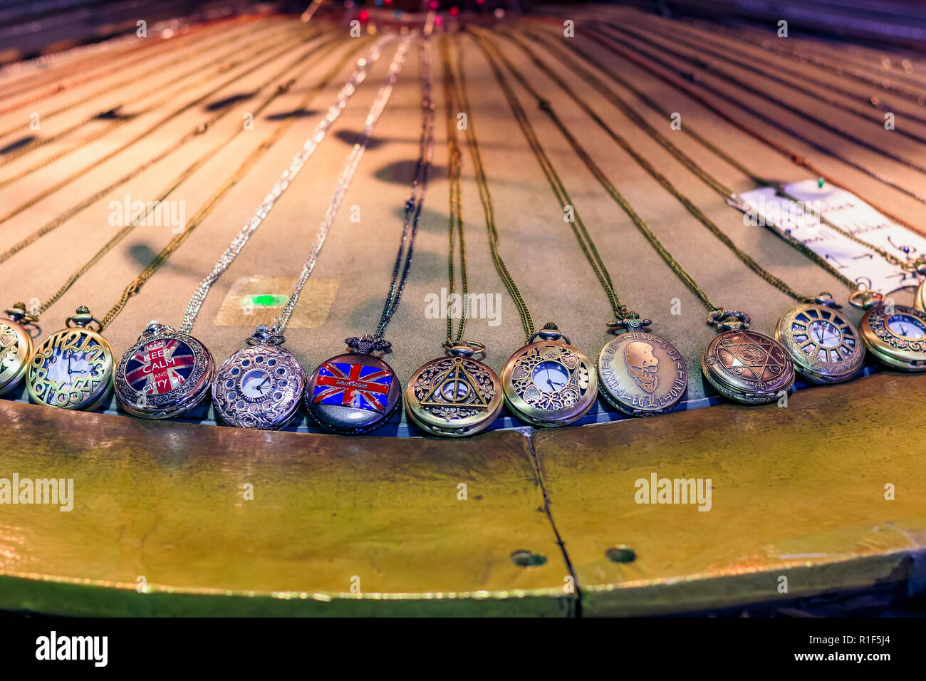Assorted pocket watches on display at Camden Market in London - Stock Image