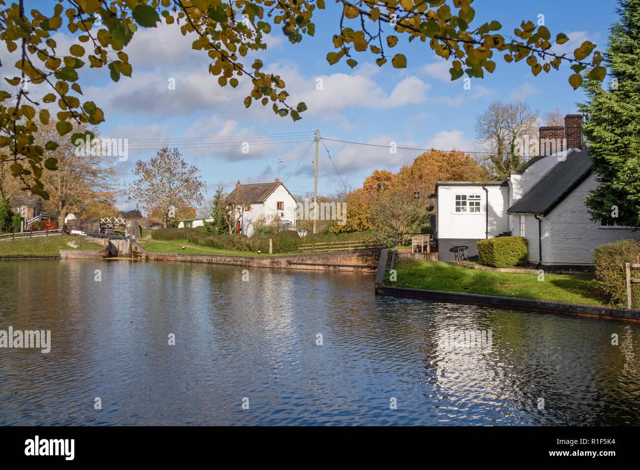 Stratford upon Avon Canal in autumn light at Kingswood Junction, Lapworth, Warwickshire, England, UK - Stock Image