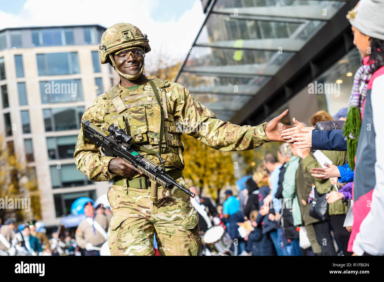 Coloured, ethnic British Army soldier interacting with the crowd at the Lord Mayor's Show Parade, London, UK. Equal opportunities. Public - Stock Image