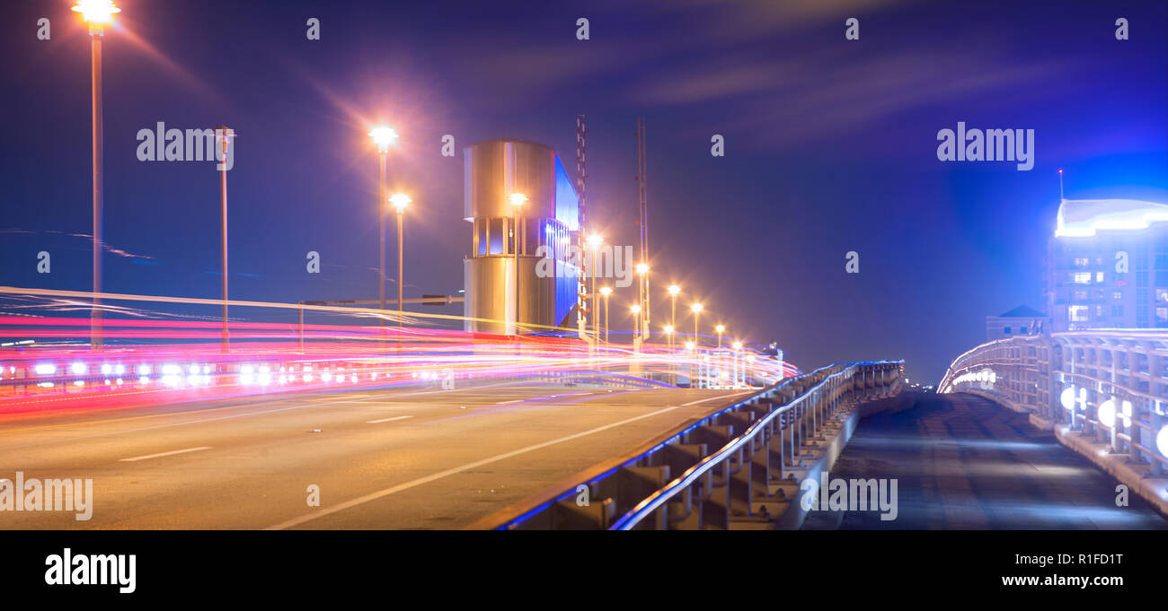 Long exposure traffic trails on the 17th Street Causeway bridge in Fort Lauderdale near Port Everglades. - Stock Image