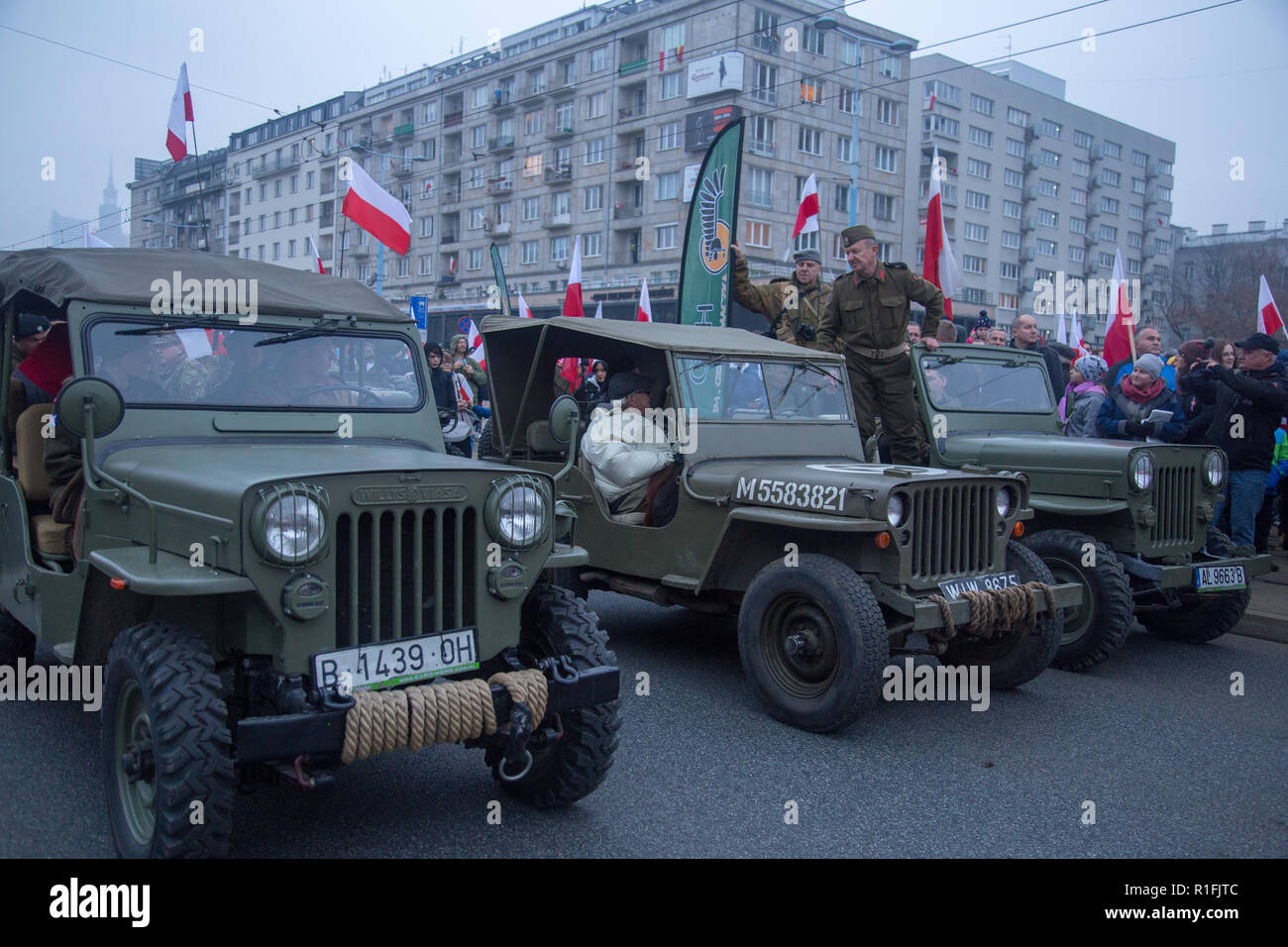 Warsaw, Poland, 11 November 2018: Celebrations of Polish Independence Day in a mass march that gathered more than 200 thousand people. Jeep Willys Viasa and Jeep Willys vehicles Stock Photo