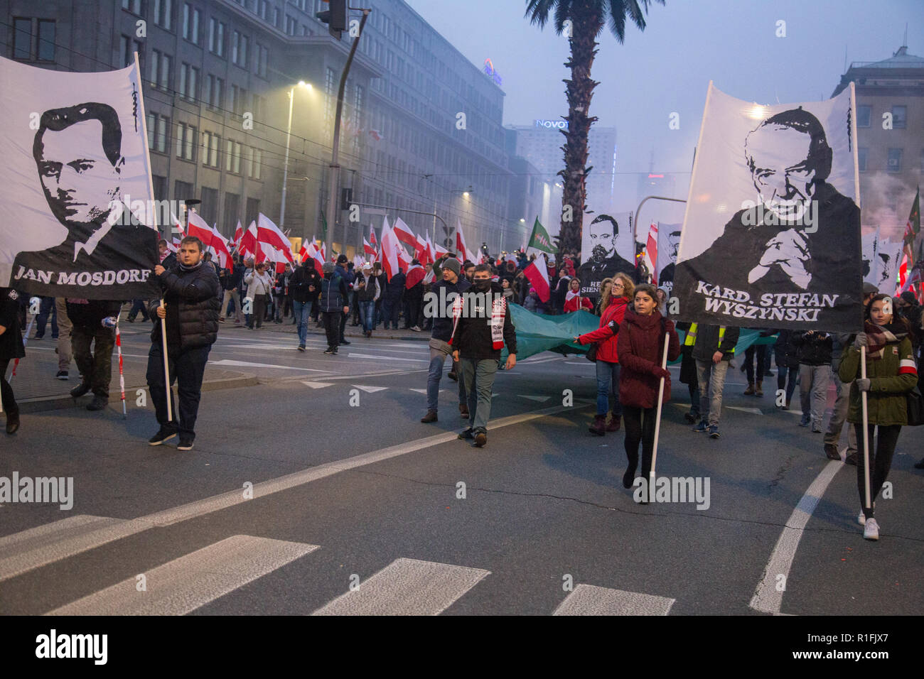 Warsaw, Poland, 11 November 2018: Celebrations of Polish Independence Day in a mass march that gathered more than 200 thousand people. All-Polish Youth (Młodzież Wszechpolska) with banners of Jan Mosdorf and Cardinal Stefan Wyszynski - Stock Image
