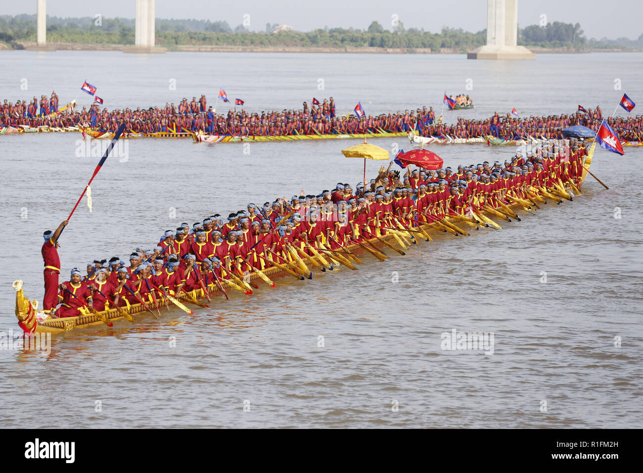 Prey Veng. 12th Nov, 2018. Photo taken on Nov. 12, 2018 shows oarsmen rowing the world's longest dragon boat (front) on the Mekong river in Prey Veng province, Cambodia. Cambodia's 87.3-meter-long wooden boat was recorded in the Guinness Book of Records as the world's longest dragon boat on Monday, breaking the previous record held by China. Credit: Sovannara/Xinhua/Alamy Live News - Stock Image