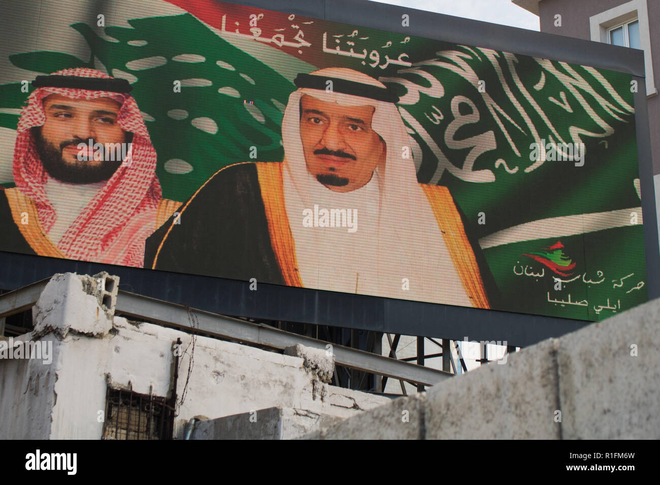 Beirut, Lebanon. 12th Nov, 2018. The portraits of Saudi Arabia Crown Prince Mohammad Bin Salman next to his father Salman of Saudi Arabia appear on an electronic advertising board in Beirut in the wake of the disappearance and untimely death of Saudi Journalist Saudi Arabian journalist Jamal Khashoggi at the Saudi Arabia embassy in Istanbul on 2 October 2018 Credit: amer ghazzal/Alamy Live News - Stock Image