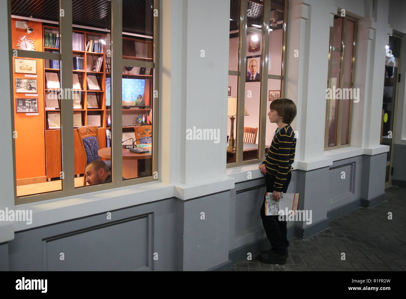 Moscow, Russia. 12th Nov, 2018. MOSCOW, RUSSIA - NOVEMBER 12, 2018: A boy during the opening of a representative office of the Russian Foreign Ministry at the Masterslavl Children's Amusement Center. Children will study diplomatic etiquette, learn to solve global problems and to answer journalists' tricky questions and will take part in negotiations in the form of a game at the representative office. Sergei Bobylev/TASS Credit: ITAR-TASS News Agency/Alamy Live News - Stock Image