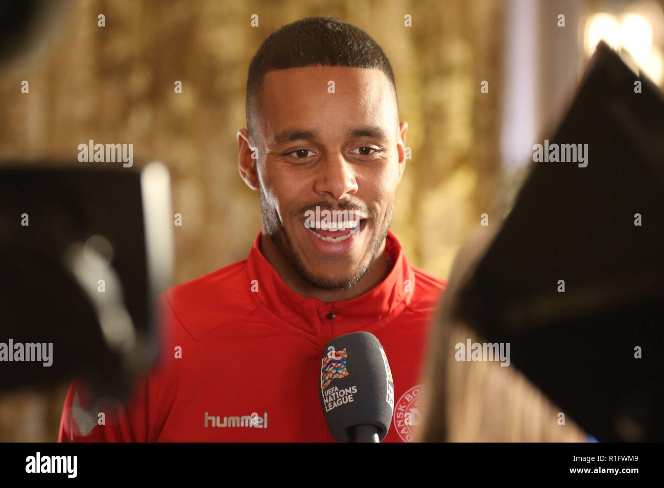 Newport, Wales, UK. 12th November, 2018. Mathias Jattah-Njie Jørgensen is a Danish professional footballer who plays as a centre back for the Premier League club Huddersfield Town and the Denmark national team. Pre-match interview at the Celtic Manor Resort near Newport ahead of Nations League match Wales v Denmark at the Cardiff City Stadium. Credit: www.garethjohn.uk/Alamy Live News - Stock Image